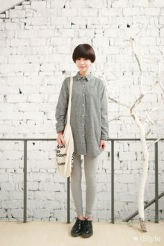 An old, slouchy men's shirt, grey slacks, Tokyo Boppers and a witty cloth bag.