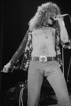 Singer Robert Plant performing with British heavy rock group Led Zeppelin at…