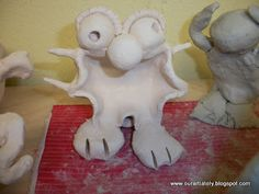 clay critter.  Pinch pot, sphere, score and slip