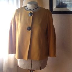 Margaret Frances swing jacket Cute retro mustard colored swing jacket. Two large decorative buttons hide snap closure. Sleeves are raglan and drop into pleating that makes a slight puff.   Pins tucks at a yoke add interest to the back. Very cute but I have too much stuff. Bought it used on ebay and haven't even worn it yet.  Fully lined, no pockets. Used but in great condition. Margaret Frances Jackets & Coats