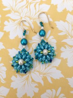 Sunday Earring Challenge. Turquoise Super Duo Earrings. Made with turquoise super duo beads, teal and pearl glass beads, 4mm Jet 2XAB Swarovski crystals and teal and lime seed beads. Design by Irene Hoffman