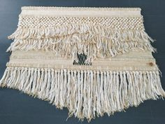 Vintage bohemian modern textile woven by Don Freedman Interlude made from wool and cotton woven around a wooden rod. The wall hanging retains its original