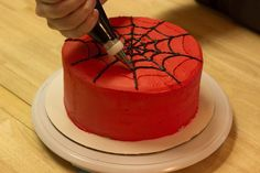 The thought of spiderwebs on a cake may conjure up unpleasant images, but if a cake is decorated with Spider-Man-styled frosting webs, that changes the story. Make a Spider-Man. Spiderman Torte, Spiderman Birthday Cake, Superhero Cake, Superhero Kids, Spiderman Web, Spider Man Birthday, Spiderman Pictures, Superman Cakes, Birthday Cakes For Men