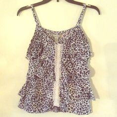 Leopard Print Love Change Tank Top Size Small❤️ Cute Leopard Print Size Small Tank! Very Cute!  If you have any questions feel free to ask!  Thanks for looking! Make an offer! BUNDLE 3 items in my Closet and receive 30% off at Checkout All purchases Come with a surprise gift! Thanks for shopping Posh!  Love Change Tops Crop Tops