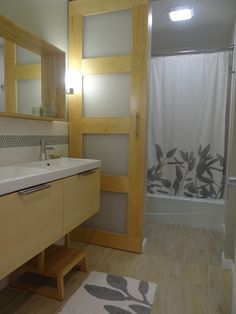 O, hold my breath. Shoji magic. Plus, notice how they built a box around the mirror. Very cool.  The Main Bath Reveal   One Project at a Time - DIY Blog
