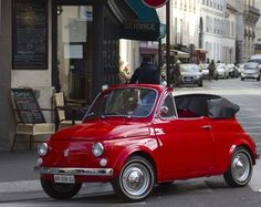 The Fiat 500.. old school.. and sooo cute in red!