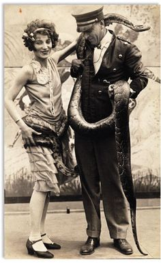 Mademoiselle Cleo, snake charmer and Paul T. Gilbert author and adventurer in 1921 at the Sells-Floto Circus.