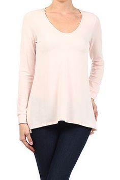 Solid color knit top with long sleeves and scoop neck.  48% Polyester / 48% Rayon / 4% Lycra  Hand Wash Cold / Hang Or Line Dry  Available only in Peach.