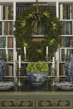 Blue and white porcelain, silver, greenery and green fruit for Christmas