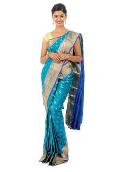 We added a unique blend of traditional Shari's to make you symbolize the perfect depiction of artistry in modern era.  Choose this Kanchipuram Silk designed gorgeously with full body in aqua blue color with handwoven bordered design crafted with rain drop zari border in golden and navy blue color.