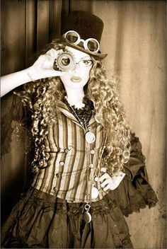 I think the other thing that makes it steampunk for girls is the long, wavy, natural hair that contrasts the industrial feel of the clothes and environment.