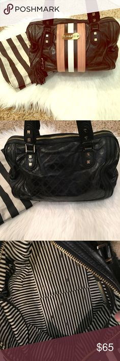 """L.A.M.B. Music Fadeout Satchel In used condition but lots of life left! Made of glazed lambskin with debossed details. Double handles. Zip closure w/ signature pull. Black-and-white stripe lining. Interior zip pocket. Dimensions: 13""""L x 6""""W x 8""""H; 6"""" handle drop. IMPERFECTIONS: Scratches shown on metal hardware pieces. Wear on all corners but only 1 pictured to save pic space. Water marks on bottom. Pieces of the tassel were ripped off. Couple of small marks on front stripe. Interior in…"""