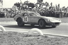 (Photo by Dave Friedman courtesy of the Ford Racing Archives) Sebring, Florida, March 21, 1964. The No. 10 Shelby American Cobra Daytona Coupe driven by Bob Holbert/Dave MacDonald on its way to 1st in GT and 4th overall in that year's 12 Hours of Sebring. The race was dominated by the Ferrari sports car prototypes, which ran 1-2-3, with Mike Parkes/Umberto Maglioli (No. 22 S.E.F.A.C. Ferrari 275 P) taking the win, followed by Ludovico Scarfiotti/Nino Vaccarella (No. 23 S.E.F.A.C. Ferrari 275…