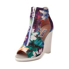 """Dive into the new Scuba Heel from Steve Madden! An Iggy Azalea and Steve Madden collaboration, the Scuba Heel features a peep-toe design with sassy vamp cutouts, vibrant floral uppers, front zip closure, and a chunky contrasting white heel. Heel 5"""""""