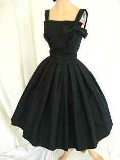 1950's Christian Dior  I adore LBD's and this is just me.  I wore a similar dress to my sons wedding, but with a tulip shape skirt.  R McN