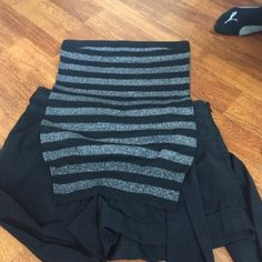 Black and silver Top with black shorts Black and silver striped tube top. Barely used Express Tops
