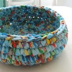 Crocheted from upcycled fabric. I think this could also work with plastic bags.