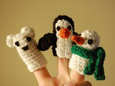 What do a penguin, a snowman, and a polar bear have in common? They make adorable winter-themed toys, of course! Finger puppets are a fun way to use up scraps of yarn, and they're so quick they make great last-minute gifts.