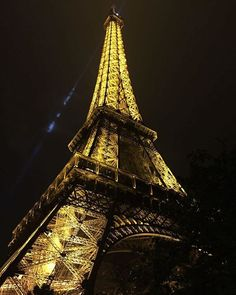 a view of the Eiffel tower at night from the base of the tower Places Around The World, Around The Worlds, Eiffel Tower At Night, Rural India, Travel News, Travel Guide, Luxury Travel, Paris France, Instagram Lifestyle