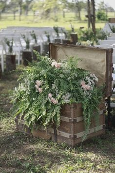 Rustic, outdoor wedding with wooden ceremony arch, ferns, baby's breath, vintage/ antique chest,