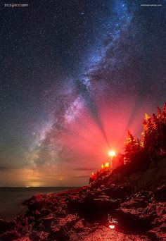 The Milky Way stretches across the sky next to Bass Harbor Lighthouse in Acadia National Park, Maine.