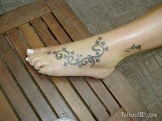 Foot Tattoo # 136 - Small and cute flowers with swirls inked on foot. Pin & like this pretty cool foot tattoo idea:)