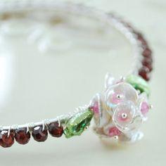 Garnet, ruby and keishi pearl floral bangle. Very girly!