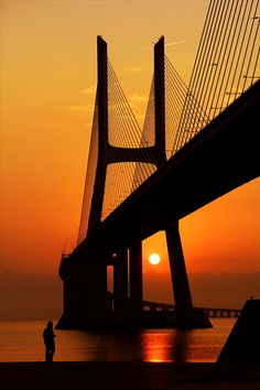 The Vasco da Gama Bridge at sunrise. It is a cable-stayed bridge that spans the Tagus River in Parque das Nações in Lisbon, Portugal. Braga Portugal, Sintra Portugal, Spain And Portugal, Portugal Travel, Places To See, Cool Photos, Beautiful Places, Scenery, Around The Worlds