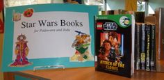 """As members of the recess coloring crowd came into Bellview library, I enlisted a few of them to decorate this sign. It showcases """"Star Wars"""" books for beginning readers (the library """"Padawans"""") as well as for more-advanced readers (""""Jedis"""") who are ready for chapter books. The cut-out characters feature various manifestations of the """"Star Wars"""" franchise including """"Angry Birds"""" and """"Lego Star Wars."""""""