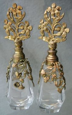 Pair of Antique clear perfume bottles with beautiful gold metal floral trim