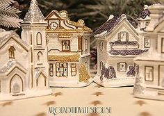 Cobblestone Corners Christmas Village repainted in ivory, silver and gold. Paint entire houses with white/ivory. Paint details with silver/gold paint.