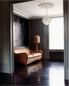 saddle-leather sofa, charcoal walls--- yes please to the whole room. Tan Leather Sofas, Best Leather Sofa, Saddle Leather, Brown Leather, Charcoal Walls, Dark Grey Walls, Painted Floorboards, Painted Floors, Black Floorboards