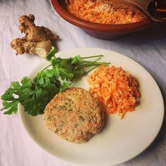 Fish burgers and raw carrot slaw. Lots of fresh ginger and coriander. Carrots are homegrown.