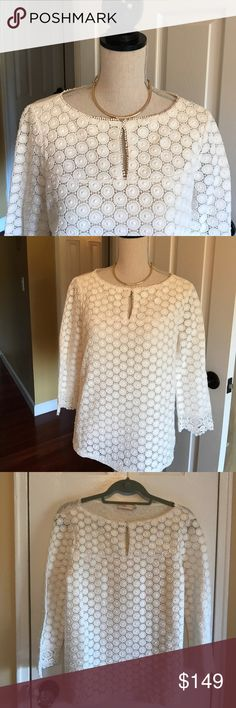 """Tory Burch eyelet top New without tags. A gorgeous TB top. Pretty details on the front. Excellent condition. Keyhole on front that can be opened. Lace detailing on bottom sleeves. Great with jeans or a skirt. There are two tiny stains on sleeve but not noticeable. Can be cleaned out. Measures 18.5"""" across and 24"""" top to bottom. Such a beautiful piece!! No trades. 100% linen. The lining is 100% silk. Tory Burch Tops Blouses"""