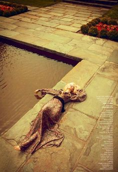 Ophelia laying by the water thinking about Hamlet promo photo as foreshadowing