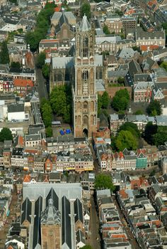 Utrecht, The Netherlands. The Dom Tower about 110 m high. A severe storm blew away a part of the church, so now the Tower stands on its one (behind the Tower you see what is left of the church). Utrecht, Rotterdam, Kingdom Of The Netherlands, Holland Netherlands, South Holland, I Amsterdam, Travel Goals, Places To See, Beautiful Places