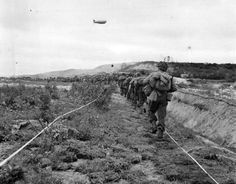 US_Infantrymen_Advance_thru_German_Minefield_in_Normandy_1944
