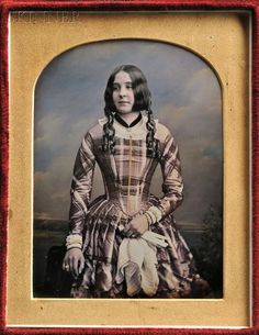 """William Edward Kilburn (British, 1818-1891). Hand-tinted Quarter-plate Daguerreotype of a Young Woman, in a leather case stamped """"BY APPOINTMENT MR. KILBURN 234 REGENT STREET"""" in gold.  (Continued in comments.)"""