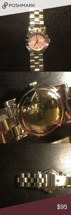Marc Jacobs watch Gently used Marc Jacobs watch in good condition.  Has pink face with clear sparkly rhinestones.  Has a few minor scratches that are not noticeable when wearing.  Has brand new battery that was just replaced.  Very cute watch. Stainless steel. Marc by Marc Jacobs Accessories Watches