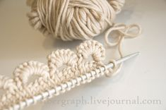 tutorial in pictures (Japanese blog) you need knitting needles as well as a crochet needle, it´s cro-tting ;)