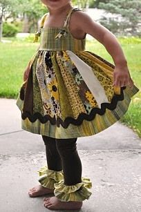 DIY children's knot dress and ruffle leggings.  So cute!  Love the ric rac trim.