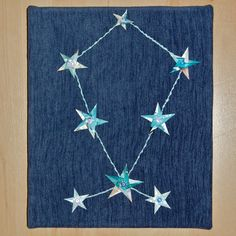 'Bootes' constellation artwork Embroidery and origami paper stars on canvas stretched fabric by Louise S.A. Allen