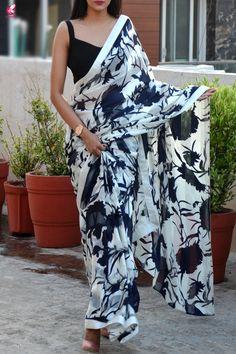Buy Blue & White Printed Crepe Satin Taping Saree - Sarees Online in India Crepe Saree, Satin Saree, Chiffon Saree, Saree Jacket Designs, Bridal Sarees South Indian, Saree Designs Party Wear, Saree Jackets, Saree Poses, Elegant Saree