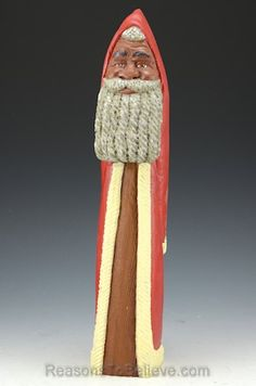 """""""Red and white black Santa Claus carving. A very special and unique, one of a kind, hand crafted African American wooden Santa. Designed, carved, painted, finished and signed by Paul Green."""""""