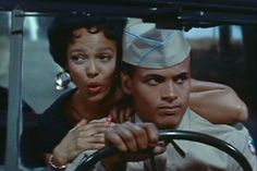 Dorothy Dandridge sings over the shoulder of Harry Belafonte as he drives a jeep in a scene from Carmen Jones Best Actress Oscar, Harry Belafonte, Dorothy Dandridge, Vintage Glamour, Vintage Films, Black Goddess, Movie Songs, My Black Is Beautiful, Movie Photo