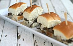 Philly Cheese Steak Sliders -roast beef, onions, peppercini, rolls WITH crabcake sliders