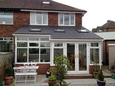 Mr and Mrs Ruffell of Brighouse converted their existing conservatory in to a Garden room by replacing the polycarbonate roof with a Solid Conservatory Roof Conservatory Roof, House Extension Design, Summer House Interiors, House Styles, Exterior Design, Roof Installation, Modern Cabin, Sunroom Designs, Grand Homes