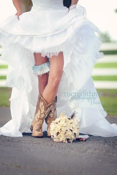 Cute picture of the bride in cowboy boots.  Love the garter in the shot as well.  Photo by Meredith Rae Photography