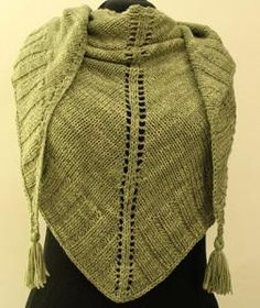 Glamorous Green Shawl - Stay warm in elegance with this Glamorous Green Shawl. This gorgeous knitting pattern is a classic triangle shawl that will go with almost anything you wear, making it a great wrap to keep by the back door for sitting out on your patio or deck on summer evenings. This free knitting pattern shows you how to make a wrap with tassels at the ends, adding a fun touch to the beautiful shawl that you are going to love to wear time and time again.