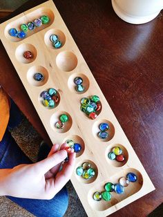 Mancala: great game for ages 6 and up. Good for family game night, kids playing together, or a parent and only child. Night Kids, Family Game Night, Games To Play With Kids, Baby Foot, Only Child, Easy Entertaining, Social Work, Best Games, Kids Playing